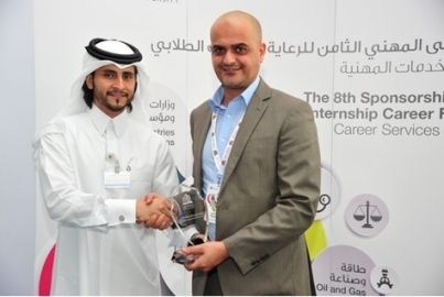 Receiving token of appreciation from Qatar University for Active participation in Sponsorship and Internship Forum on Nov. 2013